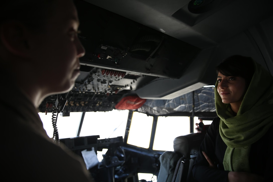Capt. Niloofar Rahmani, the first female fixed-wing pilot in the Afghan Air Force, speaks with a female pilot from Marine Aerial Refueler Transport Squadron 352 in a KC-130J Super Hercules aboard Marine Corps Air Station Miramar, Calif., March 9. Rahmani received the 2015 International Women of Courage award by the Department of state for her courage in advocating women's rights despite personal risk.