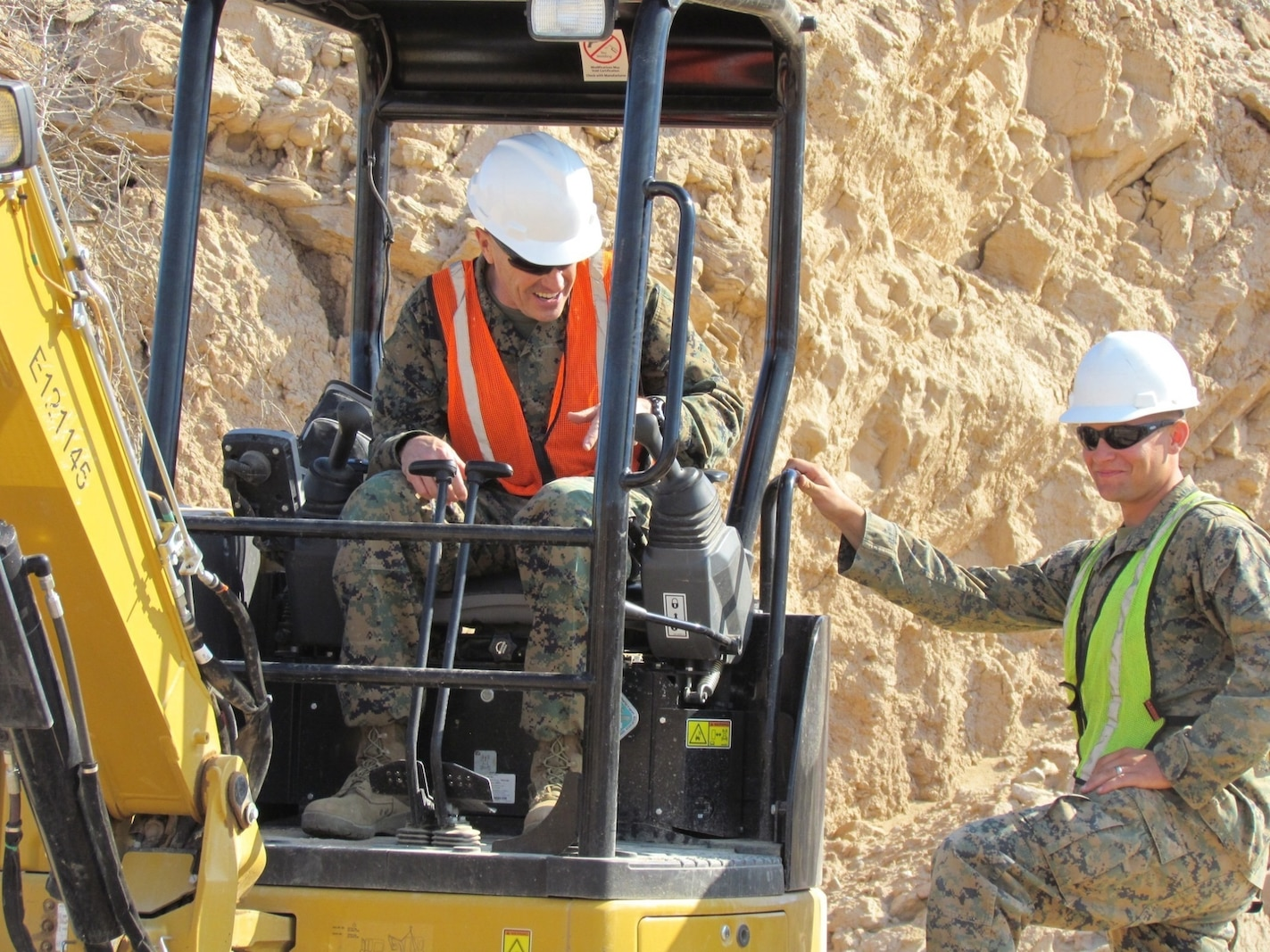 Major Gen. Vincent Coglianese, left, 1st Marine Logistics Group Commanding General, talks with a combat engineer Marine with 7th Engineer Support Battalion, 1st MLG, during a visit to El Centro, California, Feb. 26, 2015.  Marines arrived during January, providing engineering support to construct an all-weather road in El Centro, California, along the United States-Mexico border to increase U.S. border patrol mobility and support the interdiction of transnational threats. (U.S. Marine Corps photo by 1st Lt. Thomas Gray/ Released)