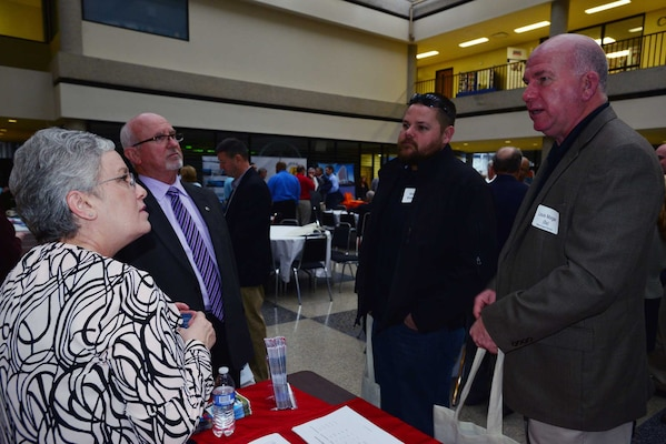(Left to Right) Jacque Gee, deputy for Small Business at the U.S. Army Corps of Engineers Louisville District Business Office, Roy Rossignol, chief of the U.S. Army Corps of Engineers Nashville District Business Office and talk with Braxton Broeson and Louis Morgan at a Small Business Forum March 11, 2015, at the Tennessee State University Avon Williams Campus in Nashville, Tenn.