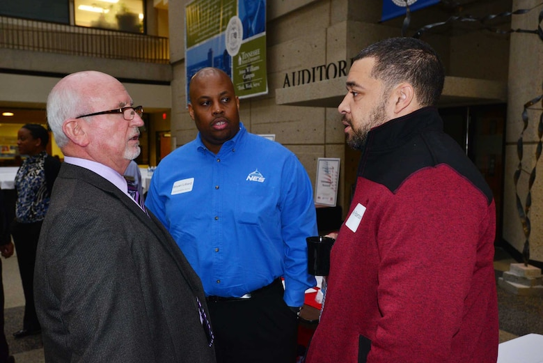 (Left) Roy Rossignol, chief of the U.S. Army Corps of Engineers Nashville District Business Office, talks with Bryan Lillard (center) and Telly Robertson (right) at the Small Business Forum March 11, 2015, at the Tennessee State University Avon Williams Campus in Nashville, Tenn.