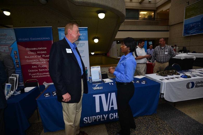 Althea Jones, supply chain senior program manager, Tennessee Valley Authority in Chattanooga, Tenn., talks with Wayne Palmer a business leader during the Small Business Forum, March11, 2015, at the Tennessee State University Avon Williams Campus in Nashville, Tenn.