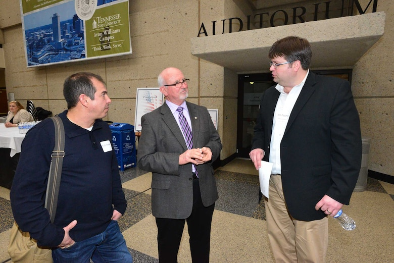 Roy Rossignol (Center), chief of the U.S. Army Corps of Engineers Nashville District Business Office, talks with Rudy Villarreal (left) and Jim Foucher (right) at the Small Business Forum March11, 2015, at the Tennessee State University Avon Williams Campus in Nashville, Tenn.