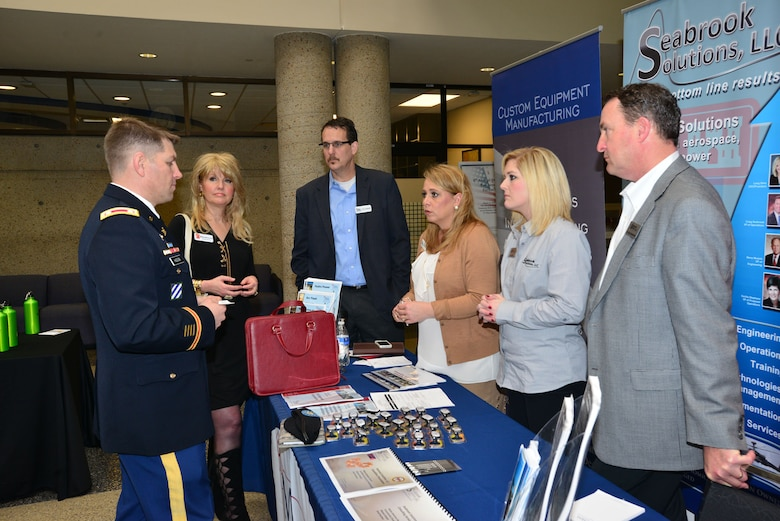 (Left to right)Lt. Col. John L. Hudson, Nashville District commander, talks with Jeanette Reynolds, Edwards Supply Company, Timothy Cutshaw and Jennifer Moore, Mesa Associates, Lang Sims and Craig Seabrook, Seabrook Solutions, at the Small Business Forum, March11, 2015, at the Tennessee State University Avon Williams Campus in Nashville, Tenn.