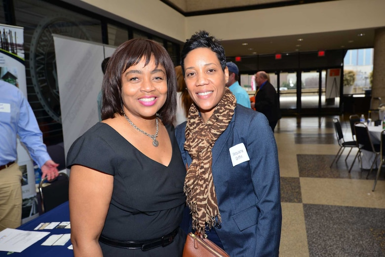 Angela Crane-Jones and Marquisha Griffin network with business leaders at the Small Business Forum, March 11, 2015, at the Tennessee State University Avon Williams Campus in Nashville, Tenn.