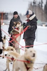 U.S. Air Force Maj. Roger Lee, a 60th Aerospace Medicine Squadron bioenvironmental engineering flight commander assigned to Travis Air Force Base, Calif., prepares Morgan, a sled dog on Team Jenssen, for the Iditarod sled dog race March 10, 2015, Fairbanks, Alaska.  Lee trained with dog sled teams in order to gain experience toward becoming a competitor in future races. (U.S. Air Force photo by Senior Airman Peter Reft/Released)