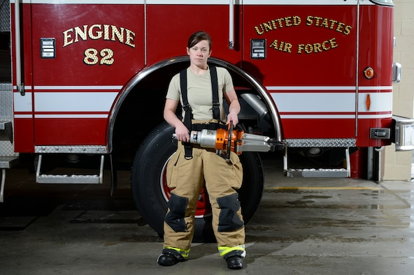 U.S. Air Force Kaylee Goodwin, a 354th Civil Engineer Squadron firefighter, stands with a spreader March 6, 2015, at Fire Station 2, Eielson Air Force Base, Alaska. The spreader is a hydraulic vehicle extrication tool designed to free crash victims from automobile wreckage and other rescues from small spaces. (U.S. Air Force photo by Senior Airman Peter Reft/Released)