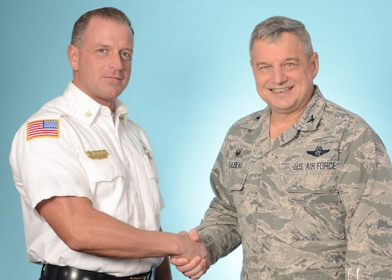 Assistant Fire Chief Joseph Foucha (left), 914th Fire Emergency Services, is congratulated on being selected the Air Force Reserve Command's Department of Defense Civilian Fire Officer of the Year by Col. Alan Teauseau, 914th Mission Support Group commander, Niagara Falls Air Reserve Station, N.Y. March 4, 2015.  (U.S. Air Force photo by Peter Borys)
