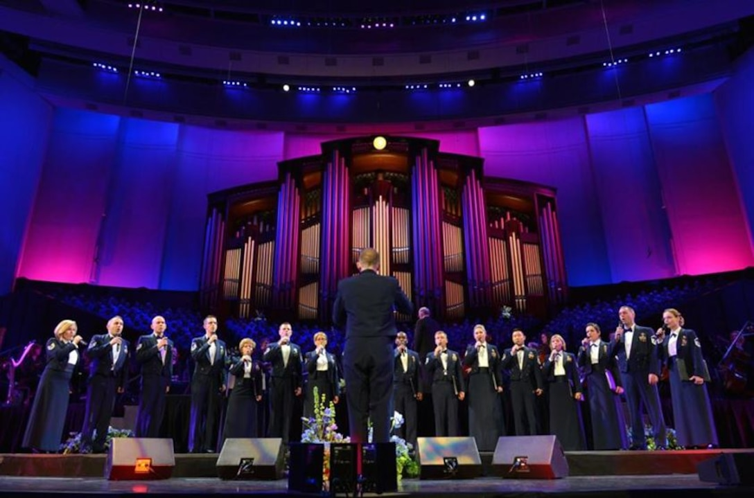 The Singing Sergeants, conducted by Capt. Joseph Hanson, were featured at the American Choral Directors Association national conference in Salt Lake City, on Feb. 28 at Temple Square. Later in the program, they joined the Mormon Tabernacle Choir and the Orchestra and more than 2,000 young choral musicians from around the country for a glorious mass choir performance before approximately 20,000 attendees. (U.S. Air Force photo by Senior Master Sgt. Bob Kamholz/released)