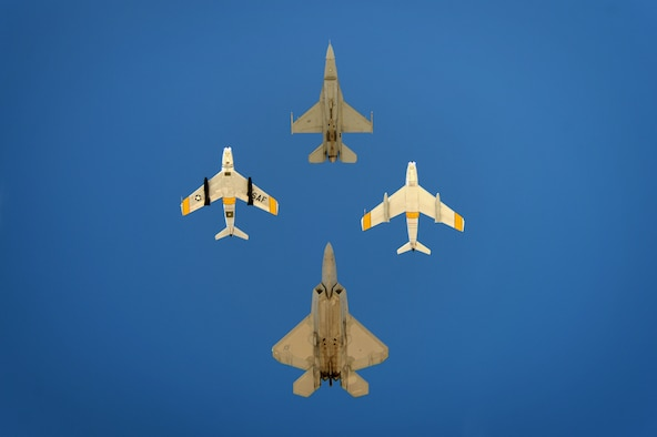U.S. Air Force Capt. Craig Baker, F-16 Viper Demo Team pilot, leads the formation of an F-22 Raptor and the F-86 Sabre during the Heritage Flight Certification and Training Course at Davis-Monthan Air Force Base, Ariz., Feb. 27, 2015. During the four day course, Baker learned to fly Heritage Flights with several HF aircraft. (U.S. Air Force photo by Senior Airman Jensen Stidham/Released)