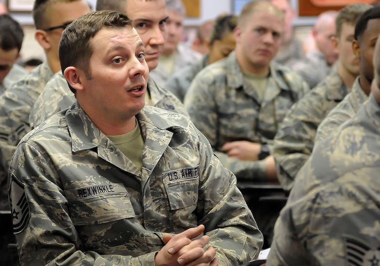 Master Sgt. Christopher Rexwinkle, 138th Civil Engineering Squadron, speaks to the 138th Fighter Wing commander and command chief during a wing commander's town hall meeting 7 March 2015, at the Tulsa Air National Guard base, Okla.   The command staff visited select units on the installation, and plan on rotating visitations throughout all the organizations during future UTA's.  (U.S. National Guard photo by Tech. Sgt. Roberta A. Thompson/Released)
