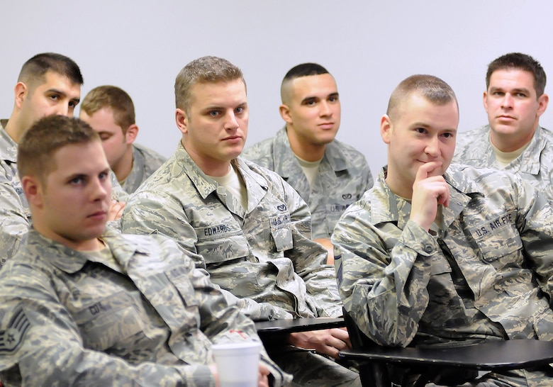 Members of the 138th Civil Engineering Squadron listen to the 138th Fighter Wing commander and command chief during a wing commander's town hall meeting 7 March 2015, at the Tulsa Air National Guard base, Okla.   The command staff visited select units on the installation, and plan on rotating visitations throughout all the organizations during future UTA's.  (U.S. National Guard photo by Tech. Sgt. Roberta A. Thompson/Released)