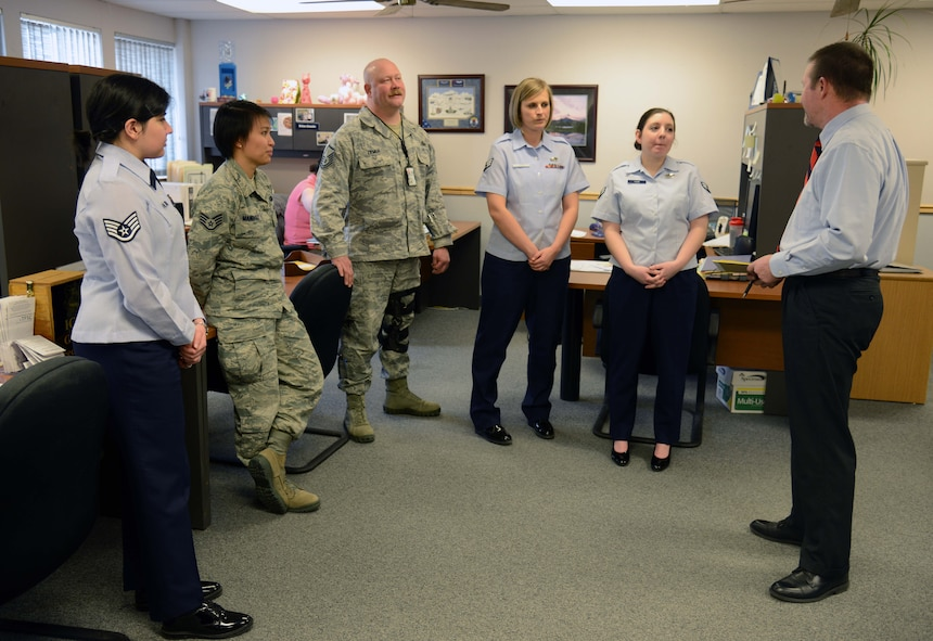 Ken Sylva, right, 341st Force Support Squadron military personnel chief, conducts a training session with members of the MPS staff March 11 at Malmstrom Air Force Base, Mont. Sylva believes it is important to meet regularly with the MPS team to train and discuss improving processes to deliver the best possible service to customers. (U.S. Air Force photo/Airman 1st Class Dillon Johnston)