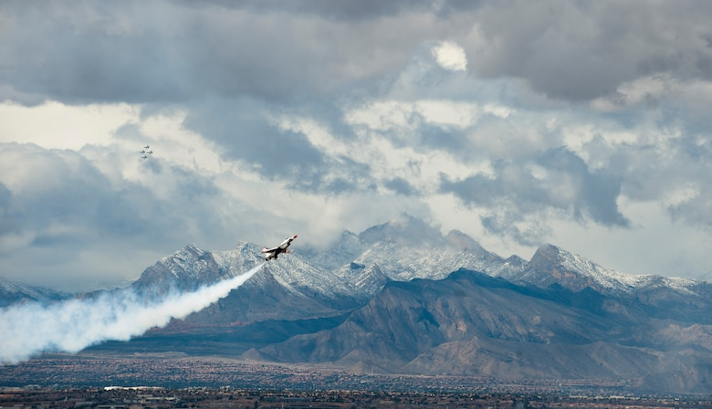 The U.S. Air Force Thunderbirds perform their demonstration March 2, 2015, in preparation for the commander of Air Combat Command at Nellis Air Force Base, Nev. The Thunderbirds perform their show several times a year at multiple locations across the U.S. The solo pilots integrate their own routines, exhibiting some of the maximum capabilities of the Air Force's premier multi-role fighter jet. (U.S. Air Force photo/Senior Airman Thomas Spangler)
