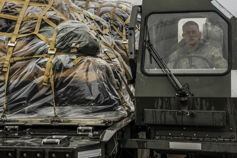 Airman 1st Class Tylor Borggen drives a K Loader packed with cargo March 4, 2015, at Little Rock Air Force Base, Ark. The supplies belonged to a group of Airmen that were deployed to Afghanistan. Borggen is a 19th Logistics Readiness Squadron air transportation specialist. (U.S. Air Force photo/Airman 1st Class Harry Brexel)