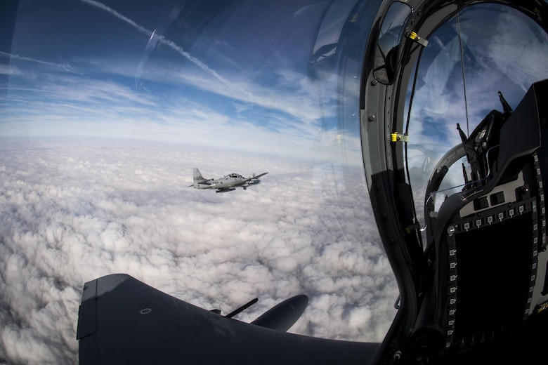 An 81st Fighter Squadron instructor pilot flies an A-29 Super Tucano March 5, 2015, over Moody Air Force Base, Ga. The A-29 is a two-seat training aircraft flown by an instructor pilot and student pilot. (U.S. Air Force photo/Senior Airman Ryan Callaghan)