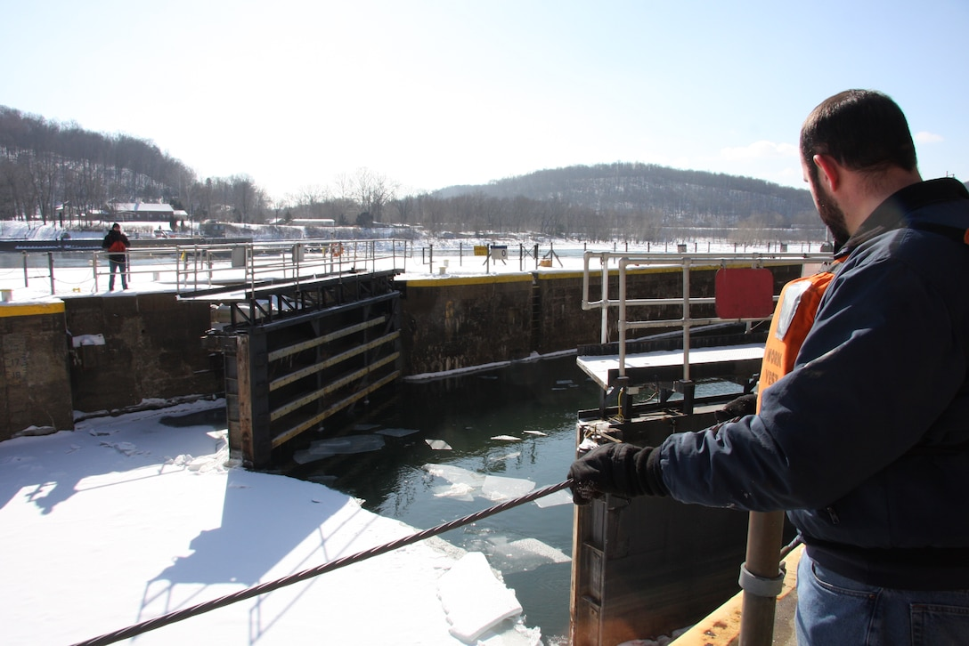 Dominic Basile, Allegheny River L/D 5 equipment mechanic leader, watches as the lock gates are cycled to try to break up the ice.