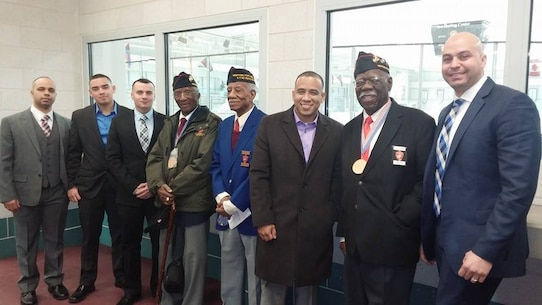 The Marines from Marine Corps Recruiting Substation Brooklyn pose for a photo with three of the original Montford Point Marines. Numerous Montford Point Marines spoke to the Marines of Recruiting Station New York about their experiences at the Bethpage Community Park Feb. 27. The Montford Point Marines fought two wars, one abroad and one at home. While they fought for freedom overseas, they returned home to a nation that was separate and unequal. Breaking through racial barriers, they transformed the face of the Marine Corps.