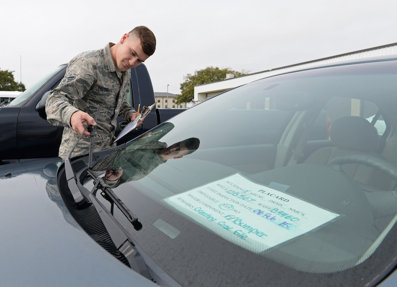 Senior Airman Ryan Fitzgerald, 81st Logistics Readiness Squadron vehicle management and analysis technician, inspects a vehicle March 11, 2015, Keesler Air Force Base, Miss. The more than 40 member maintenance flight repair and oversee more than 420 government vehicles that belong to Keesler. (U.S. Air Force photo by Senior Airman Holly Mansfield)
