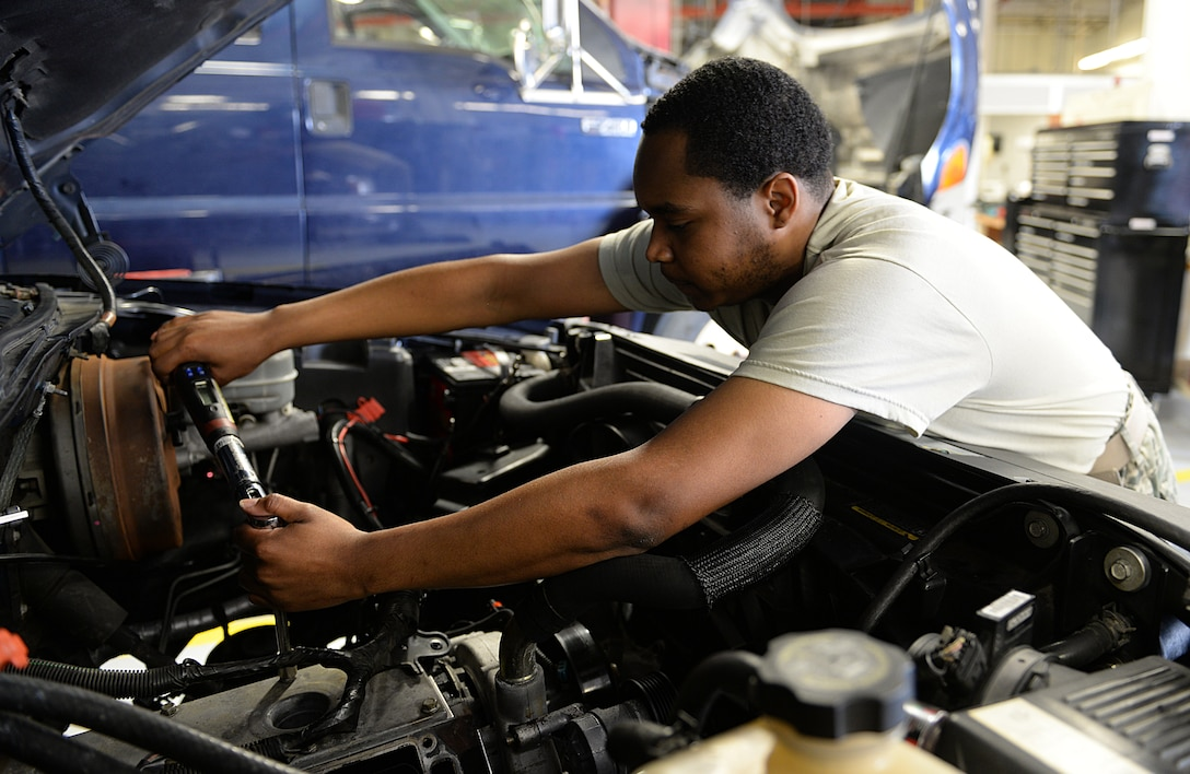 Senior Airman Kenneth Carter, 81st Logistics Readiness Squadron vehicle maintenance technician, repairs a security forces truck March 11, 2015, Keesler Air Force Base, Miss. The more than 40 member vehicle maintenance flight repair and oversee more than 420 government vehicles that belong to Keesler. (U.S. Air Force photo by Senior Airman Holly Mansfield)
