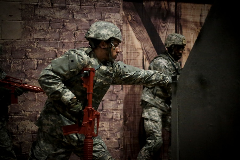 U.S. Army Soldiers participate in a Modern Army Combatives Program (MACP) training scenario at the New Jersey National Guard Training and Training Technology Battle Lab at Joint Base McGuire-Dix-Lakehurst, N.J., March 11, 2015. The Battle Lab features numerous combat simulators, as well as an indoor urban area for ground combat training. (U.S. Air National Guard photo by Tech. Sgt. Matt Hecht/Released)