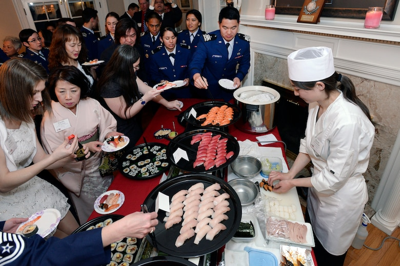 The Consulate-General of Japan in Denver's official cook (right) prepares a meal at the Japanese Tomodachi Dinner here Feb. 24, 2015, hosted by the Academy's commandant of Cadets, Brig. Gen. Stephen Williams and his wife, Holly.