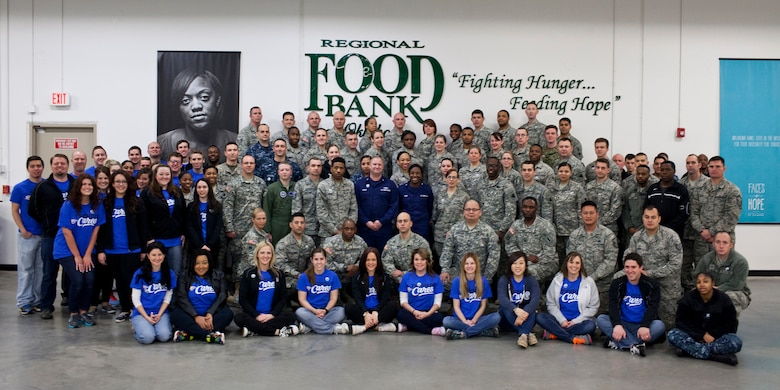 Staff members with the Oklahoma City Thunder and servicemembers from across Oklahoma pose for a photo during a joint NBA and Department of Defense volunteer event at the Regional Food Bank of Oklahoma on Monday. (Photo courtesy of Regional Food Bank of Oklahoma)