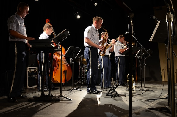 The Air Force Band of the Pacific's Papana, from Joint Base Pearl Harbor Hickam, Hawaii, performs jazz ensembles at the University of Guam March 11, 2015. The Air Force Band of the Pacific's Papana supports the U.S. Pacific command strategies of partnership, readiness and presence by conducting protocol, community and nation-building missions throughout the Pacific. (U.S. Air Force photo by Airman First Class Alexa Ann Henderson/Released)