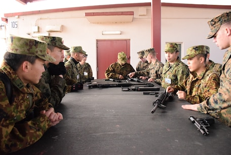4 Mar 2015, Camp Fuji, Gotemba Japan (Photo by G5 Junko Akabane, Bilateral Engagement Coordinator, Co-Op Visit #75, JGSDF) - Students in the Bilateral Engagement Program of the US Army Japan visiting CATC Camp Fuji received a familiarization brief on weapons from the CATC Camp Fuji Armor, as well as briefs about Marine Corps tactical vehicles and equipment.  The Co-Op Group visits Camp Fuji 4 times a year to conduct language interaction training and enhance interoperability and overall inter-service awareness.