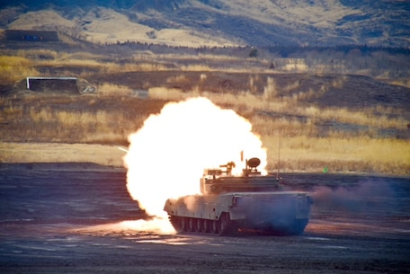 A Type 90 tank fires a round from its main gun at a target downrange in the Eastern Fuji Maneuver Area on March 9, 2015. Several Marines from CATC Camp Fuji observed the tank fire competition that was performed by the JGSDF.