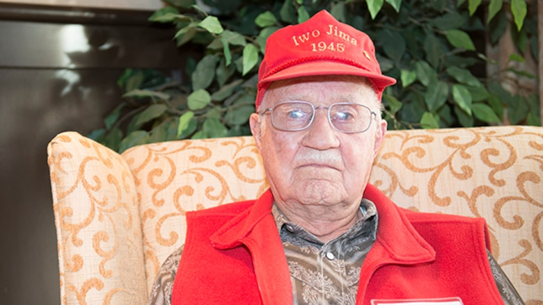 Raymond Lueb, Marine survivor from the battle of Iwo Jima, poses for a photo during the Iwo Jima Battle Survivors and Family Association 70th anniversary reunion at Wichita Falls, Texas, February 14, 2015. Lueb served in the Marine Corps from January 1944 until May 1946.
