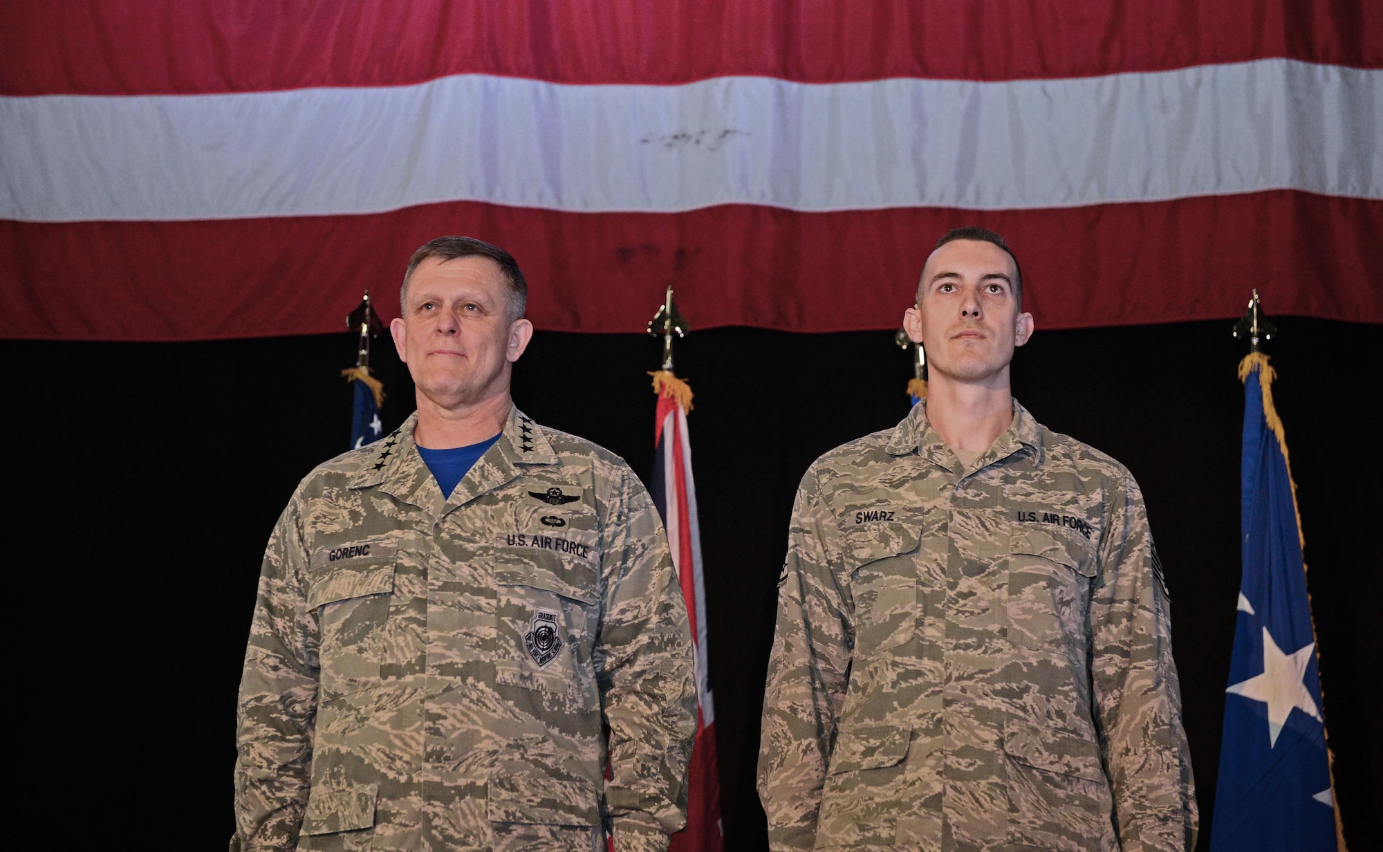 Gen. Frank Gorenc (left) and Staff Sgt. Greggory Swarz stand at attention during an Airman's Medal presentation March 13, 2015, at Royal Air Force Lakenheath, England. Swarz was recognized for his heroic actions on Jan. 26, 2015, when he saved the lives of three French airmen after a Hellenic air force F-16 Fighting Falcon crashed into the parking ramp at Los Llanos Air Base, Spain, during Tactical Leadership Program 15-1. Gorenc is the U.S. Air Forces in Europe and Air Forces Africa commander and Swarz is a 492nd Aircraft Maintenance Unit electrical environmental systems specialist. (U.S. Air Force photo/Airman 1st Class Dawn Weber)