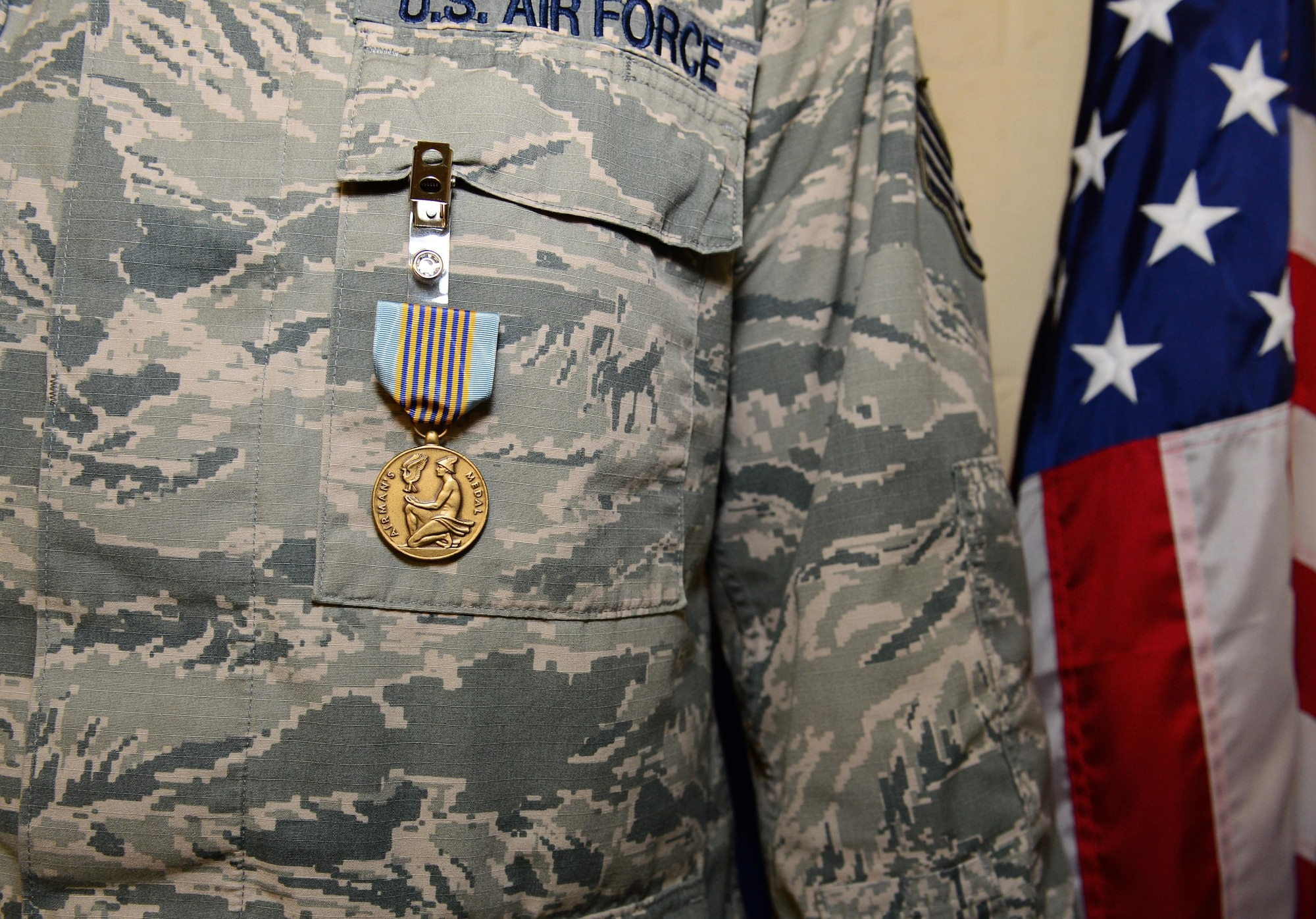 Staff Sgt. Greggory Swarz displays his Airman's Medal after a ceremony March 13, 2015, at Royal Air Force Lakenheath, England. Swarz was recognized for his heroic actions on Jan. 26, 2015, when he saved the lives of three French airmen after a Hellenic Air Force F-16 crashed into the parking ramp at Los Llanos Air Base, Spain, during Tactical Leadership Program 15-1. Swarz is a 492nd Aircraft Maintenance Unit electrical environmental systems specialist (U.S. Air Force photo/Airman 1st Class Erin R. Babis)