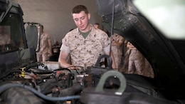 "Cpl. Connor G. Reap inspects the final bolt put in a Humvee that made Marine Air Control Squadron 4 100-percent equipment ready March 13 on Marine Corps Air Station Futenma. ""Marine Corps wide no one is at 100 percent readiness, except us right now,"" said Reap. ""There are some Marines who have been in for 20 plus years and they didn't believe it. It made me feel like a rock star to know that we are the only unit in the Marine Corps to be 100 percent ready."" Reap, from Wanaque, New Jersey, is a quality control non-commissioned officer with MACS-4, Marine Air Control Group 18, 1st Marine Aircraft Wing, III Marine Expeditionary Force."