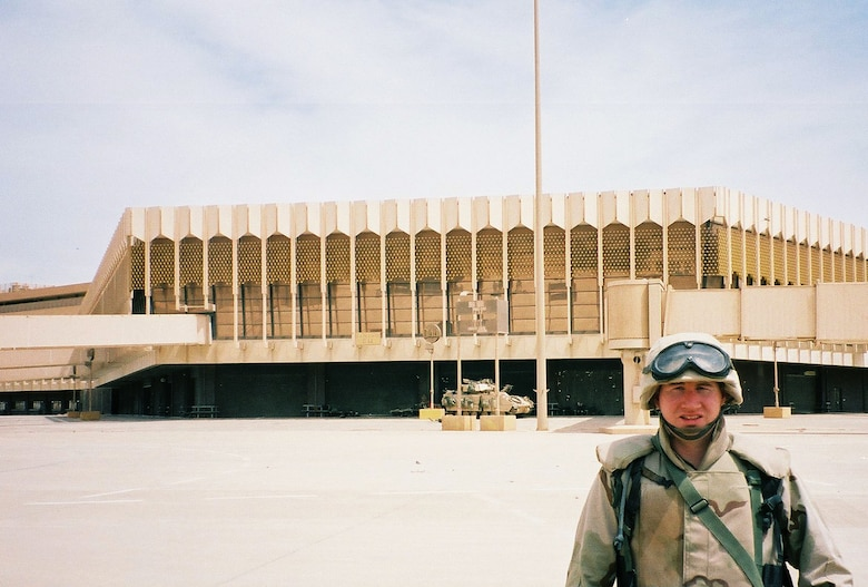 Capt. Terry J. Hamrick Jr., 315th Training Squadron flight commander, poses for a photo while deployed in Iraq, with the Army V Corps, at Baghdad International Airport April 2003. Hamrick was one of the first Air Force Intelligence specialists to deploy with an Army unit inside Iraq and is now the 17th Training Wing Vice Commander at Goodfellow Air Force Base. (Courtesy Photo)