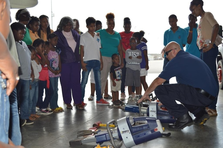 """More than 100 children and staff from 11 different partner organizations were invited for an exclusive """"Kid's Day"""" tour of the U.S. Forward Operating Location (US FOL) in Curacao March 10, 2015. The participants were given a close view at the FOL's capabilities in aircraft rescue and fire prevention, aircraft maintenance and sustainment, and airport safety and security.  This event was a combined effort involving 33 volunteer staff from the U.S. Air Force, U.S. Navy, and the HATO International Airport.  The U.S. FOL's continued partnership with local organizations demonstrates their eagerness for community involvement and their long standing appreciation for the hospitality received from the citizens of Curacao. (Courtesy photo/released)"""