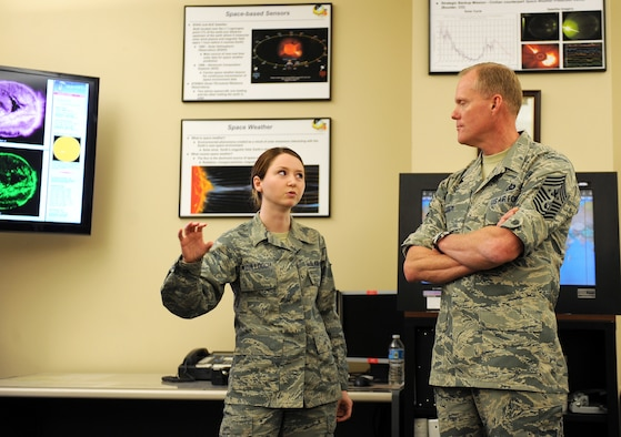 U.S. Air Force Senior Airman Robyn McCullough, 2d Weather Squadron, briefs Chief Master Sgt. of the Air Force James Cody on the role of solar weather in the Air Force March 11 at the Air Force Weather Agency, Offutt Air Force Base, Neb. This was Cody's first visit to AFWA to hear about its unique mission. (U.S. Air Force photo by Josh Plueger)