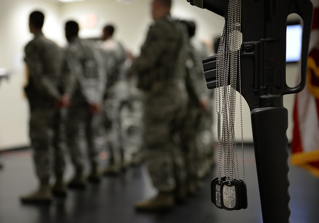 Dog tags representing fallen security forces Airmen hang on a fallen heroes memorial in the guard mount room in the security forces building March 12, 2015, Keesler Air Force Base, Miss. 81st SFS Airmen perform multiple roles to keep members of Keesler safe, ranging from identification checks at base entrances to searching for explosives and narcotics with military working dogs. (U.S. Air Force photo by Senior Airman Holly Mansfield)