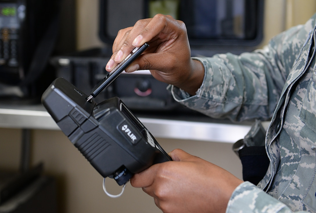 Senior Airman Ashlee Scales, 81st Security Forces Squadron commercial vehicle entry controller, uses explosive detection equipment to test for traces of explosives on vehicles entering the installation at the commercial vehicle entrance March 12, 2015, Keesler Air Force Base, Miss. 81st SFS Airmen perform multiple roles to keep members of Keesler safe, ranging from identification checks at base entrances to searching for explosives and narcotics with military working dogs. (U.S. Air Force photo by Senior Airman Holly Mansfield)