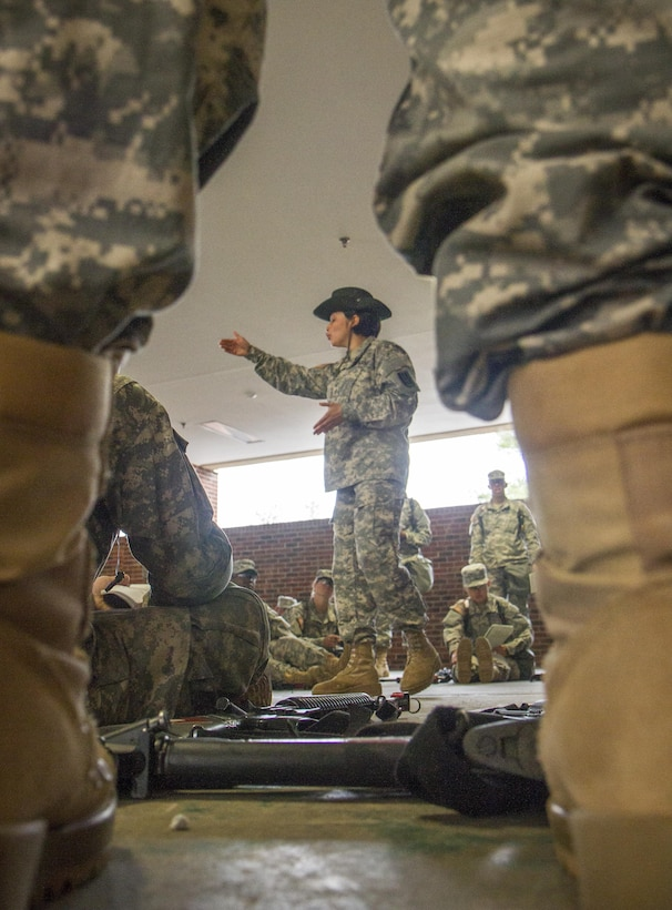 U.S. Army Drill Sgt. Rocio Torrez, of the 3rd Battalion, 60th Infantry Regiment, teaches a platoon of recruits the proper way to evacuate a casualty during white phase of basic combat training at Fort Jackson, S.C., March 14, 2015. (U.S. Army photo by Sgt. Ken Scar)