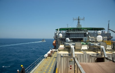 The Spanish patrol boat Infanta Elena, left, escorts the container ship MV Cape Ray through the Strait of Gibraltar en route to the Mediterranean Sea June 26, 2014. The U.S. government-owned MV Cape Ray was modified and deployed to the eastern Mediterranean Sea to dispose of Syrian chemical agents in accordance with terms Syria agreed to in late 2013. U.S. Navy photo by Mass Communication Specialist Seaman Desmond Parks