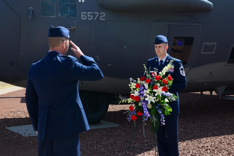 U.S. Air Force Lt. Col. Andrew Koegl, 16th Special Operations Squadron commander, renders a salute to a wreath memorializing the Air Commandos during a Jockey 14 memorial March 13, 2015 at Cannon Air Force Base, N.M. Koegl presided over a memorial ceremony that recalled Jockey 14's tragic crash off the coast of Kenya in March 1994. (U.S. Air Force photo/Airman 1st Class Shelby Kay-Fantozzi)