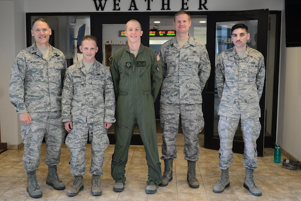 U.S. Air Force Maj. Gen. Kurt Neubauer, Air Force Safety Chief, poses with Staff Sgt. John Stevens, 27th Special Operations Aircraft Maintenance Squadron gunship support section supervisor, 1st Lt. James White, 318th Special Operations Squadron pilot, Staff Sgt. Nathan Kilborn, 27th Special Operations Support Squadron tower watch supervisor, and Senior Airman Justin Eustace, 27th SOSS tower air traffic controller, March 12, 2015 at Cannon Air Force Base, N.M. Neubauer visited Cannon to congratulate the base for its role in securing Air Force Special Operations Command's second consecutive award for the Air Force's best flight safety program. (U.S. Air Force photo/Airman 1st Class Shelby Kay-Fantozzi)