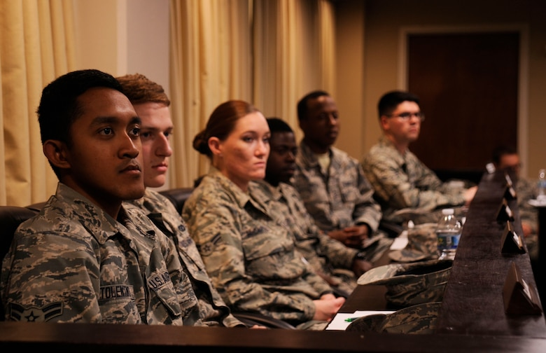 Team V Airmen sit in the jury box and listen to evidence presented during a mock court martial March 13, 2015, Vandenberg Air Force Base, Calif. The mock court martial is part of a program called 'Got Consent?', which is designed to raise awareness about sexual assault and the legal repercussions. (U.S. Air Force photo by Airman 1st Class Ian Dudley/Released)