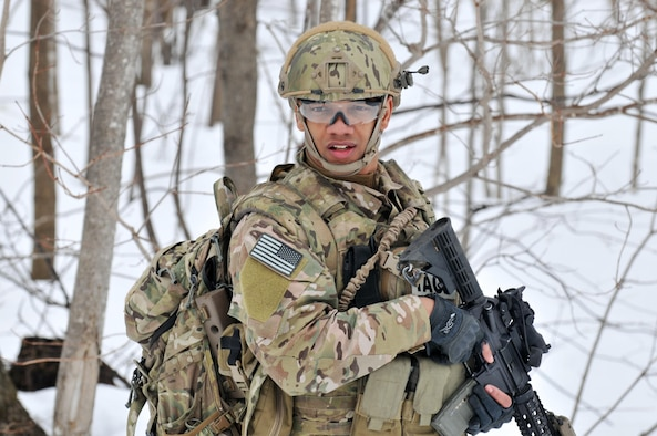 Senior Airman Joel Ramirez moves towards the objective training area during an exercise March 14, 2015, at Fort Drum, N.Y. Thirty Airmen from the New York Air National Guard's 274th Air Support Operations Squadron (ASOS), based at Hancock Field Air National Guard Base trained on close air support (CAS) as well as training for the first time with two CH-47F Chinook helicopters from Company B, 3rd Battalion, 126th Aviation based in Rochester. The 274th mission is to advise commanders on how to best utilize U.S. and NATO assets for CAS. Ramirez is a tactical air control party (TACP) Airman. (New York Air National Guard photo/Master Sgt. Eric Miller)
