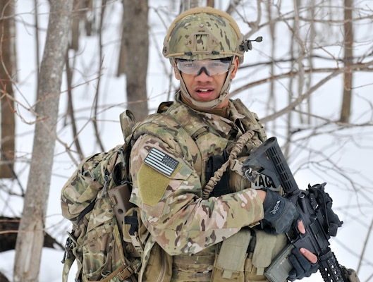 Senior Airman Joel Ramirez,a Tactical Air Control Party (TACP) Airman, moves towards the objective training area during an exercise at Fort Drum, N.Y., March 14, 2015. Thirty Airmen from the New York Air National Guard's 274th Air Support Operations Squadron (ASOS), based at Hancock Field Air National Guard Base trained on Close Air Support (CAS) as well as training for the first time with two CH-47F Chinook helicopters from Company B, 3rd Battalion, 126th Aviation based in Rochester, N.Y.