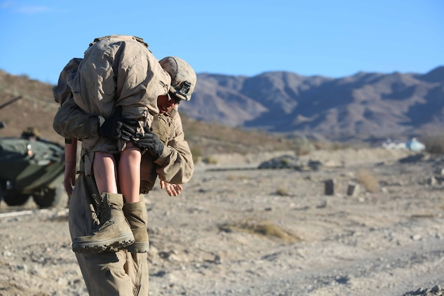 Cpl. Jeff Flores, driver, Light Armored Vehicle Platoon, Company B, Ground Combat Element Integrated Task Force, conducts a simulated casualty evacuation portion of a Marine Corps Operational Test and Evaluation Activity assessment at Range 500, Marine Corps Air Ground Combat Center Twentynine Palms, California, March 12, 2015. From October 2014 to July 2015, the GCEITF will conduct individual and collective level skills training in designated ground combat arms occupational specialties in order to facilitate the standards-based assessment of the physical performance of Marines in a simulated operating environment performing specific ground combat arms tasks. (U.S. Marine Corps photo by Cpl. Paul S. Martinez/Released)