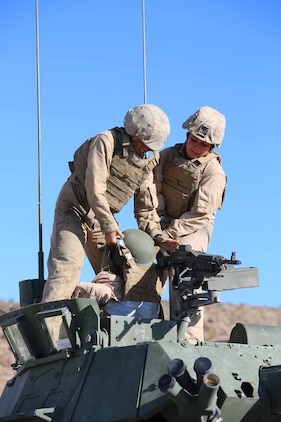 Lance Corporals Brittany R. Dunklee, left, gunner, and Ashleigh Howell, right, driver, both with Light Armored Vehicle Platoon, Company B, Ground Combat Element Integrated Task Force, conduct a simulated casualty evacuation out of an LAV during a Marine Corps Operational Test and Evaluation Activity assessment at Range 500, Marine Corps Air Ground Combat Center Twentynine Palms, California, March 12, 2015. From October 2014 to July 2015, the GCEITF will conduct individual and collective level skills training in designated ground combat arms occupational specialties in order to facilitate the standards-based assessment of the physical performance of Marines in a simulated operating environment performing specific ground combat arms tasks. (U.S. Marine Corps photo by Cpl. Paul S. Martinez/Released)