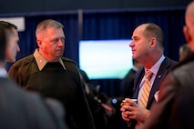LtCol Patrick Kirchner, with the Futures Directorate's Futures Assessment Division, listens as a visitor to the Naval Future Force Expo explains a potential solution to one of the Navy and Marine Corps' S&T challenges.