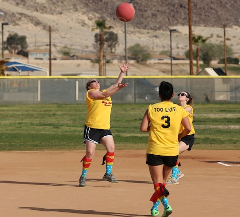 Kandi Hart, in-fielder, the First Ladies, catches the ball during a spouses' kickball game at Felix Field March 15, 2015. This is the Spouses of Twentynine Palms Area Kickball Association's first season aboard the Combat Center. (Official Marine Corps photo by Pfc. Levi Schultz/Released)