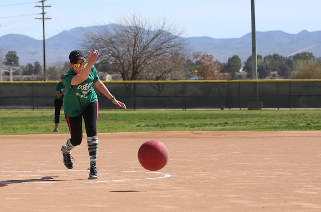 Eileen Murray, pitcher, the Grass Stains, pitches the ball during a spouses' kickball game at Felix Field, March 15, 2015. The Spring Kickball League started March 1 and is scheduled until April 15. (Official Marine Corps photo by Pfc. Levi Schultz/Released)